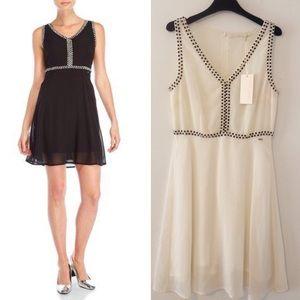 Gaudi white dress sleeveless.